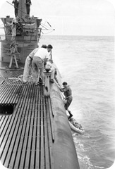 Walter Kreimann, a 78th Fighter Squdron P-51 pilot, being rescued by the submarine Tigrone.