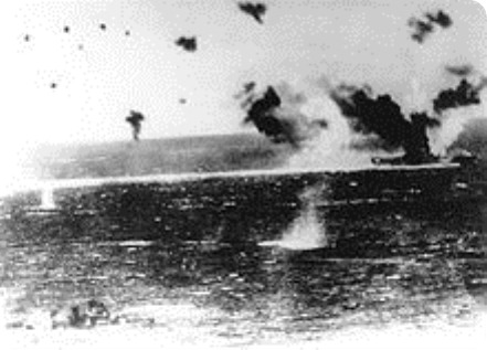 220px-USS_Lexington_under_attack_at_Coral_Sea
