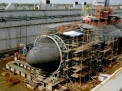 050508-N-0000X-002 Apra Harbor, Guam (May 8, 2005) – The Los Angeles class submarine USS San Francisco (SSN 711) shown in dry dock is having repairs made on its damaged bow. A new large steel dome about 20 feet high and 20 feet in diameter was put in the place of the damaged bow. San Francisco ran aground 350 miles south of Guam Jan. 8, killing one crew member and injuring 23. U.S. Navy photo (RELEASED)