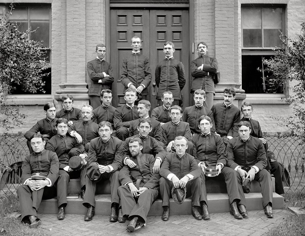 Yates Stirling Jr. (seated, upper left) with members of USNA Class of 1892